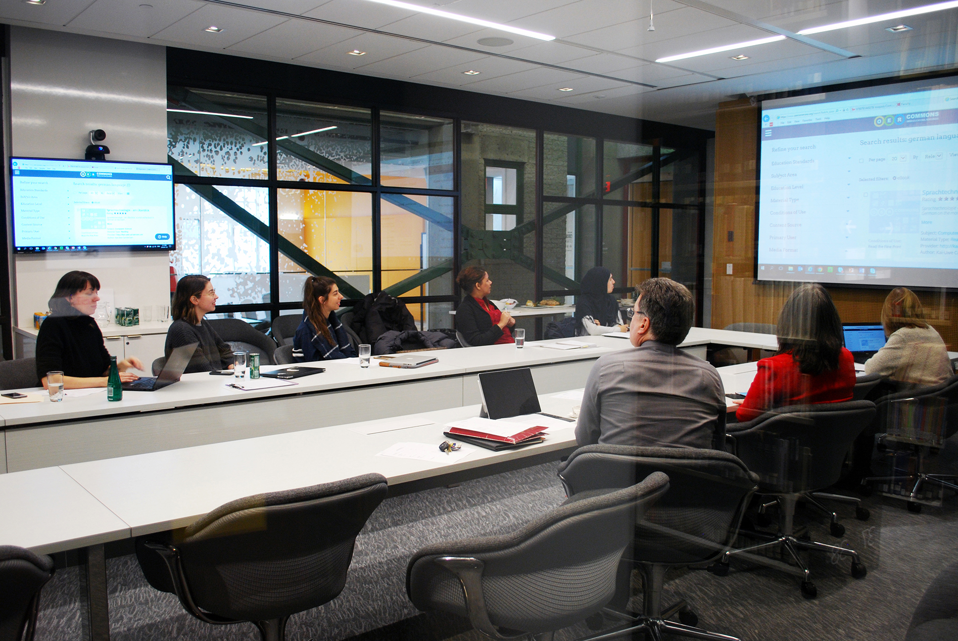 Members of the Library Services Fund watching a presentation in a conference room