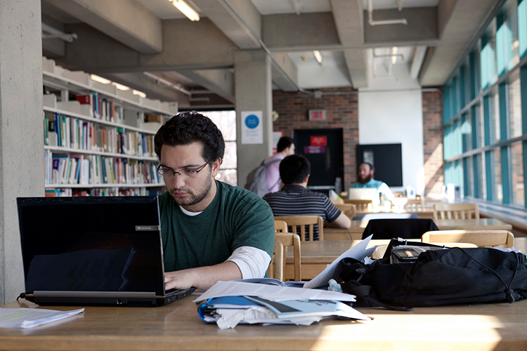 Student studying at the Vanier Library